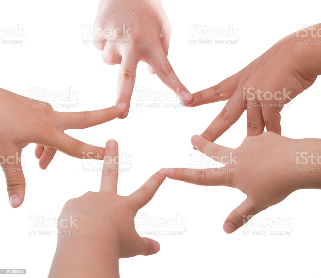 Five girl friends holding hands in a star shape stock photo