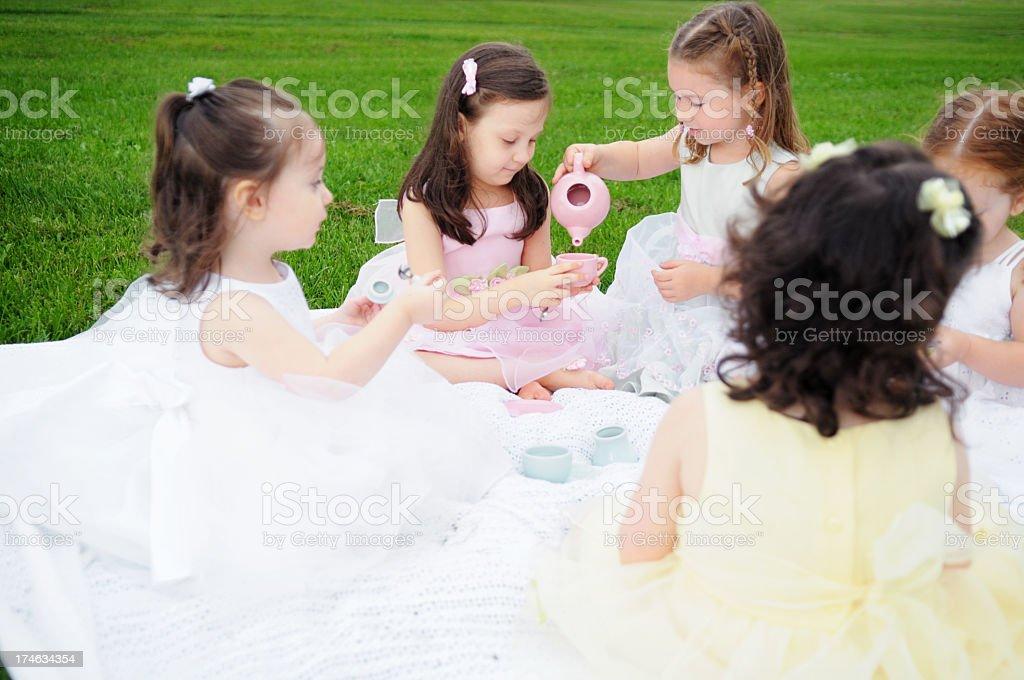 Five Girls Having a Princess Tea Party Outside royalty-free stock photo