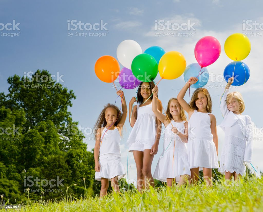 Five girls show off their multicolored balloons royalty-free stock photo