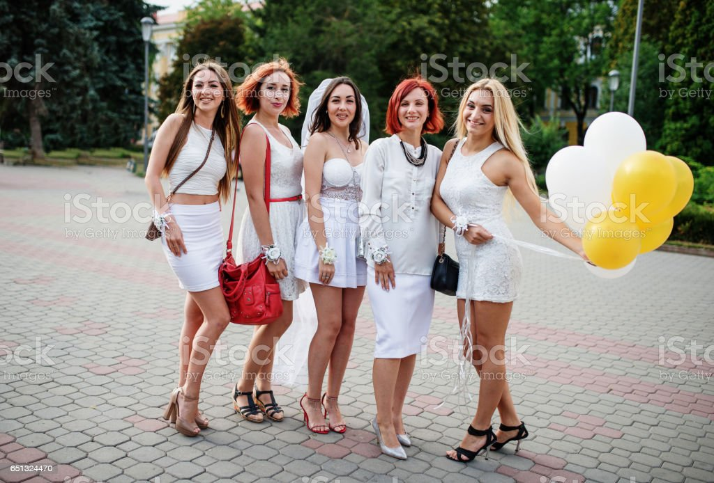 Five girls with balloons at hand on hen party. stock photo