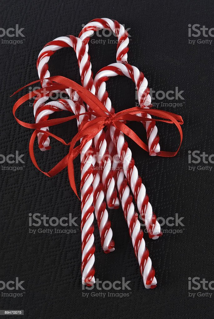 Five glass candy canes held together with a red ribbon royalty-free stock photo