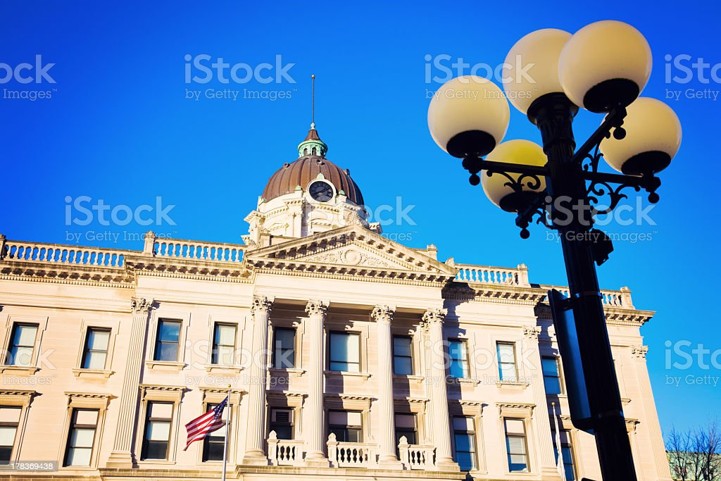 Five globe light pole with Brown County Courthouse behind stock photo
