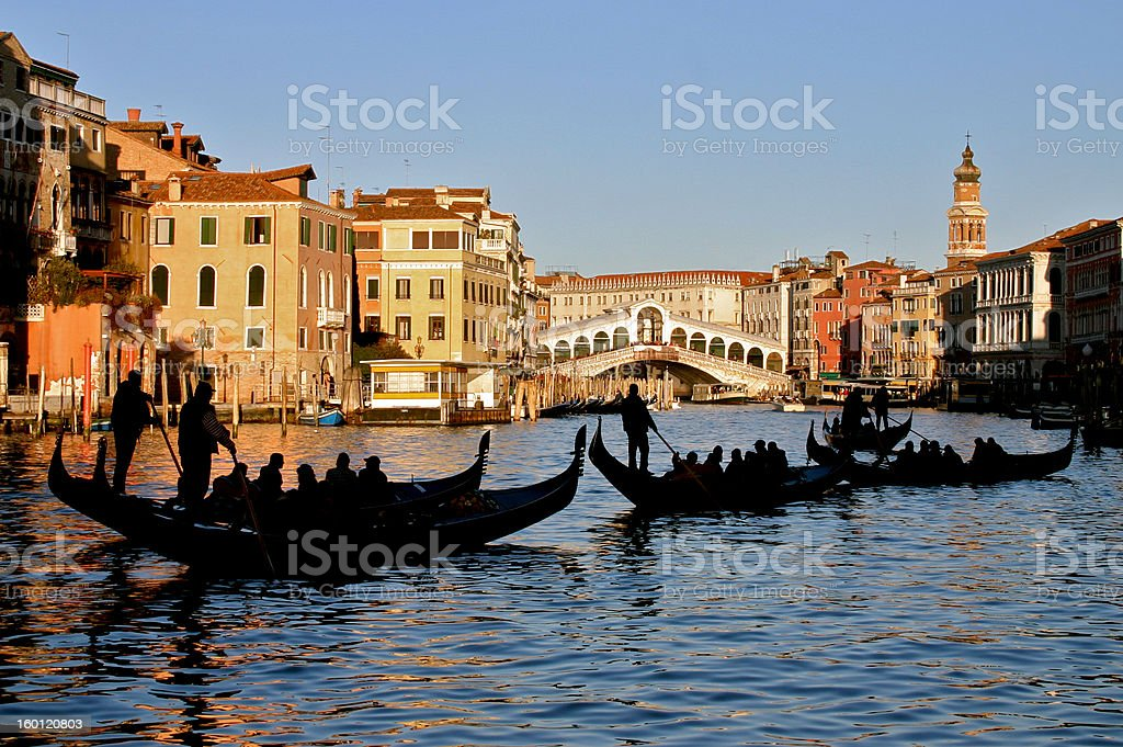 Five gondolas on the Grand Canal by Ponte Rialto royalty-free stock photo