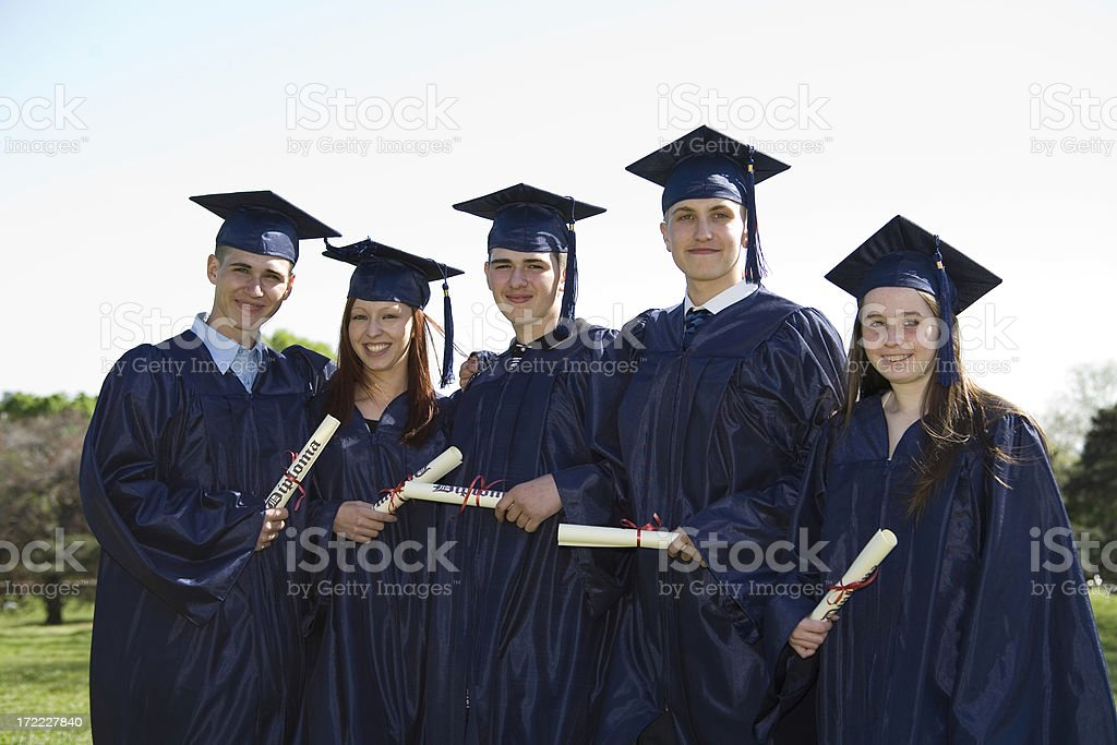 Five graduates posing to a picture royalty-free stock photo