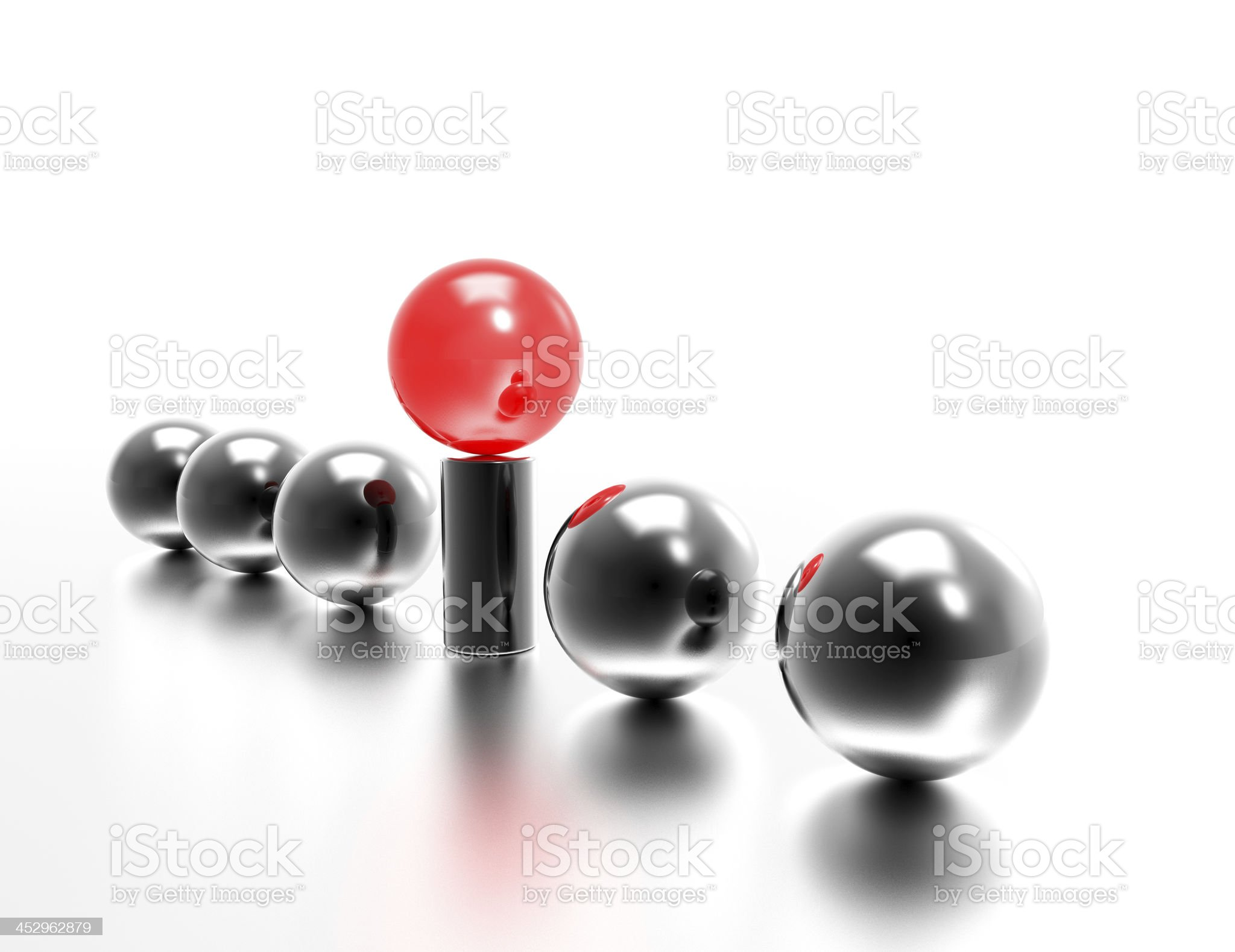 Five gray balls and one red on a pedestal royalty-free stock photo