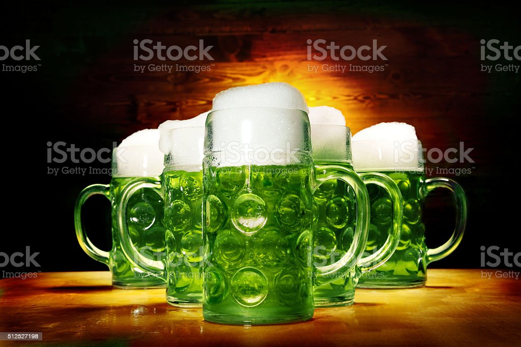 Five Green Beer Glasses on the Wooden Table stock photo