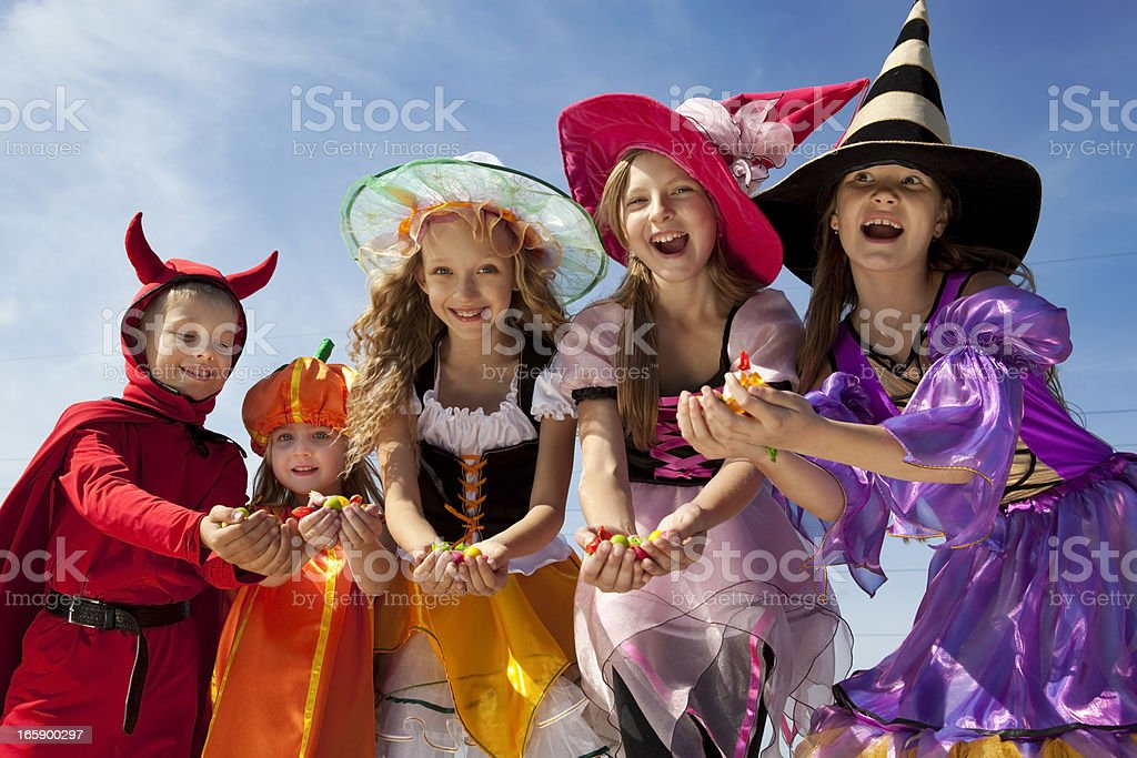 Five Halloween Children Holding Candies. royalty-free stock photo