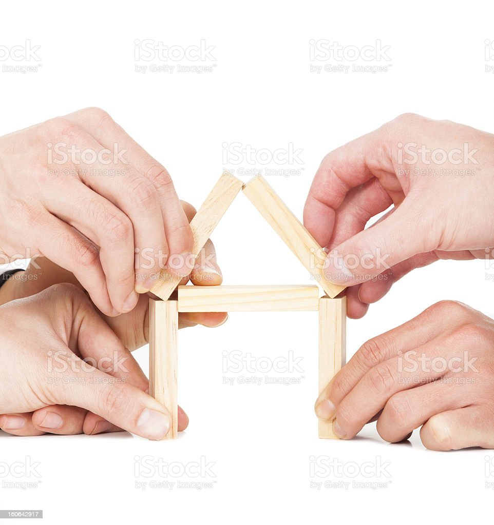 five  hands building house by wooden block royalty-free stock photo
