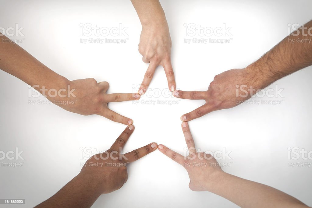 Five hands shape a star stock photo