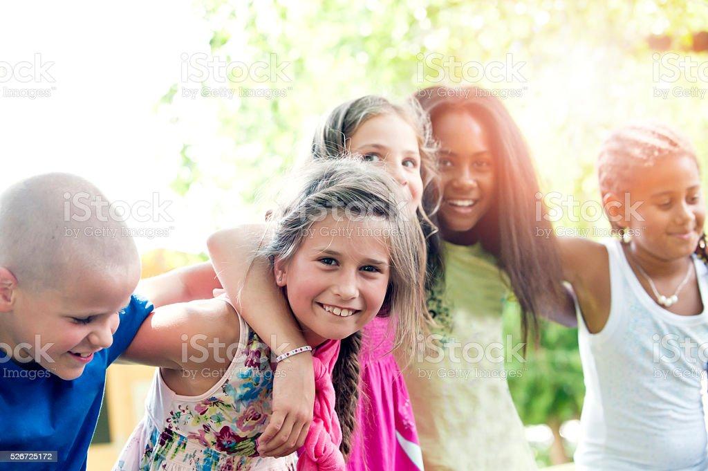 Five happy children in summer stock photo