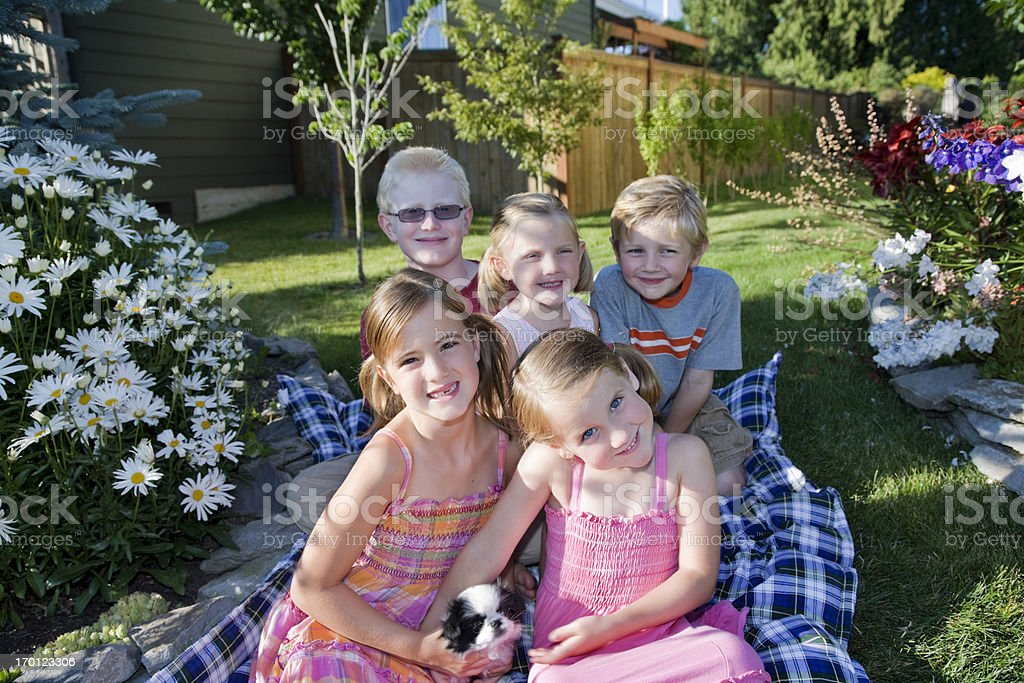 Five Happy Children on a beautiful day outdoors at home royalty-free stock photo