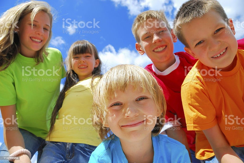 Five happy kids enjoying a sunny day outdoors royalty-free stock photo