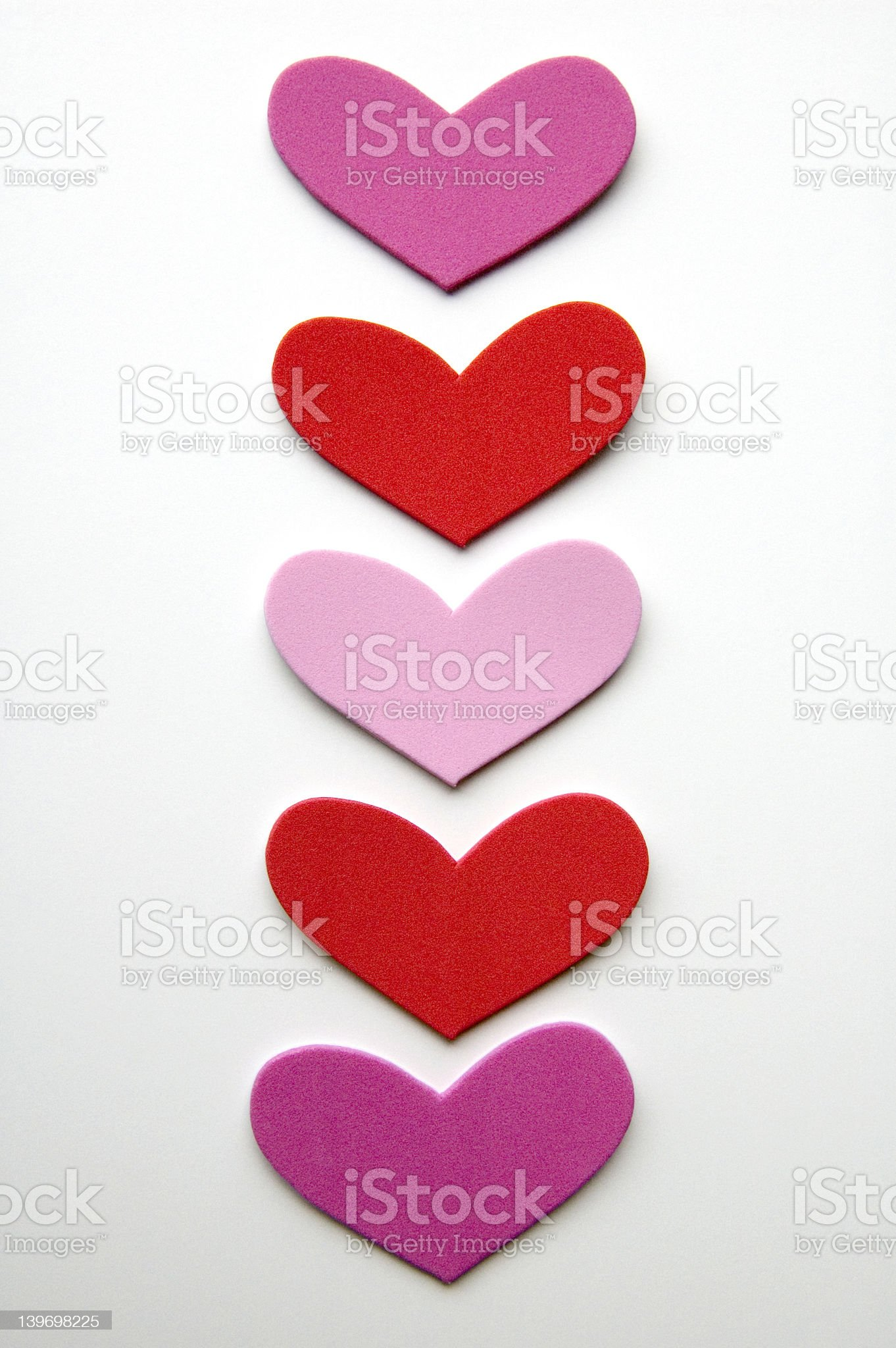 Five Hearts in a Column on White royalty-free stock photo