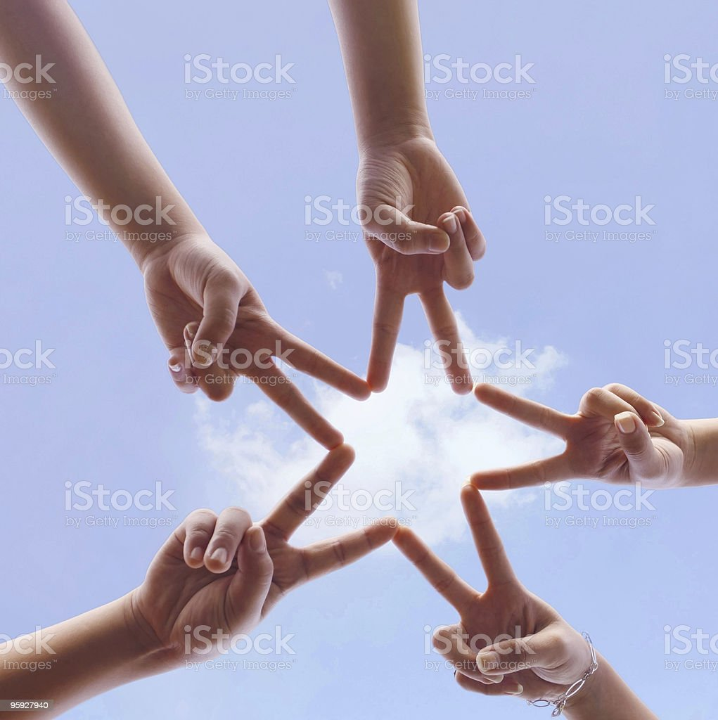 Five human hands used to make a star sign symbolic royalty-free stock photo