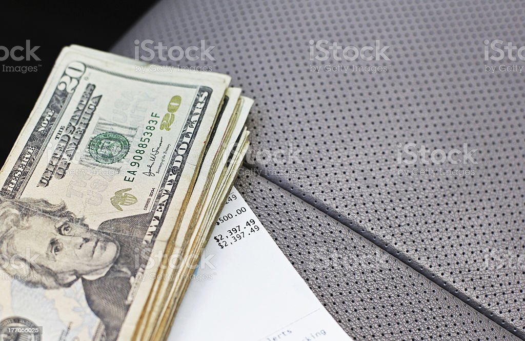 Five Hundred Dollars And Receipt on Car Seat royalty-free stock photo