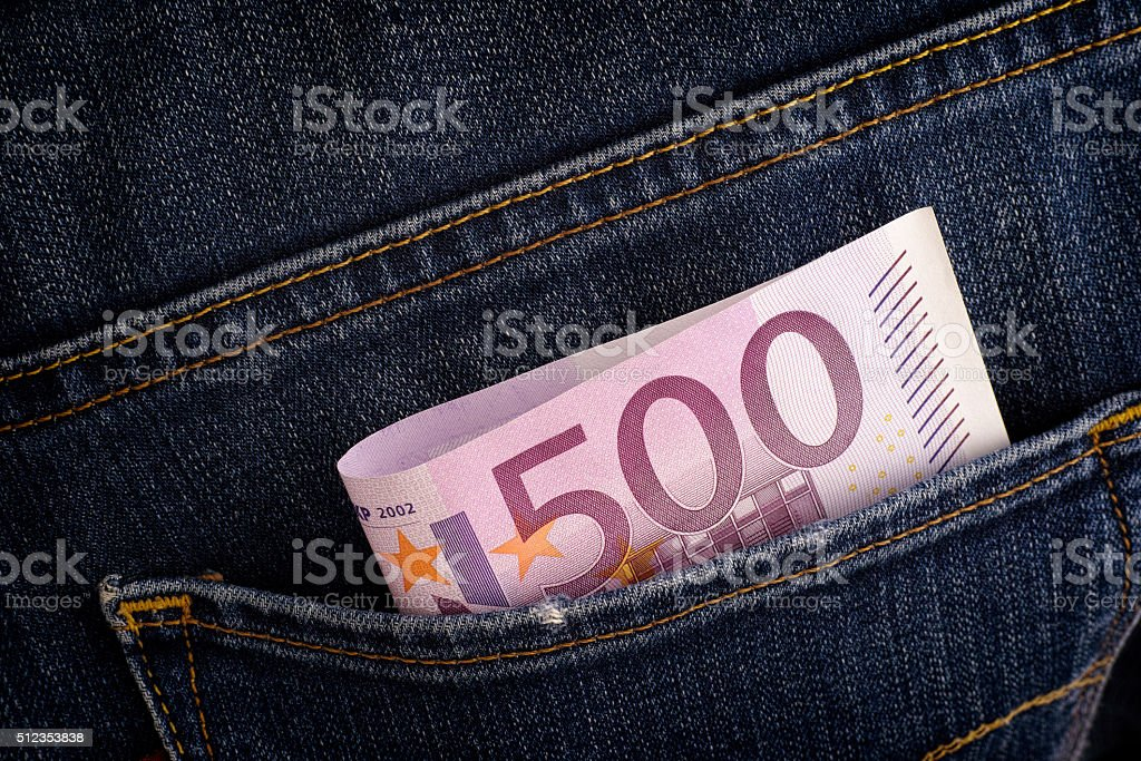 Five hundred euro banknote in back pocket of blue jeans stock photo
