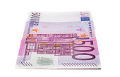 five hundred euro banknote lies lenghtwise in a white background