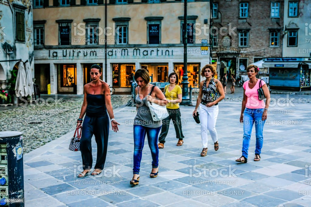 Five Italian women on a night out in Udine, Italy stock photo