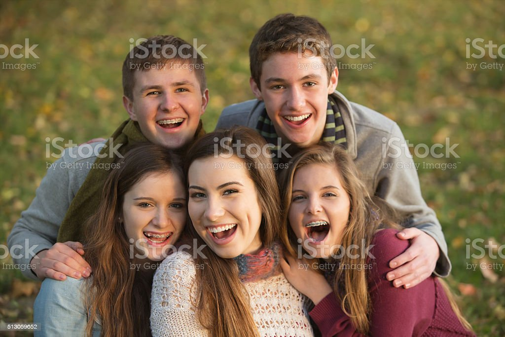 Five Laughing Teens Outdoors stock photo