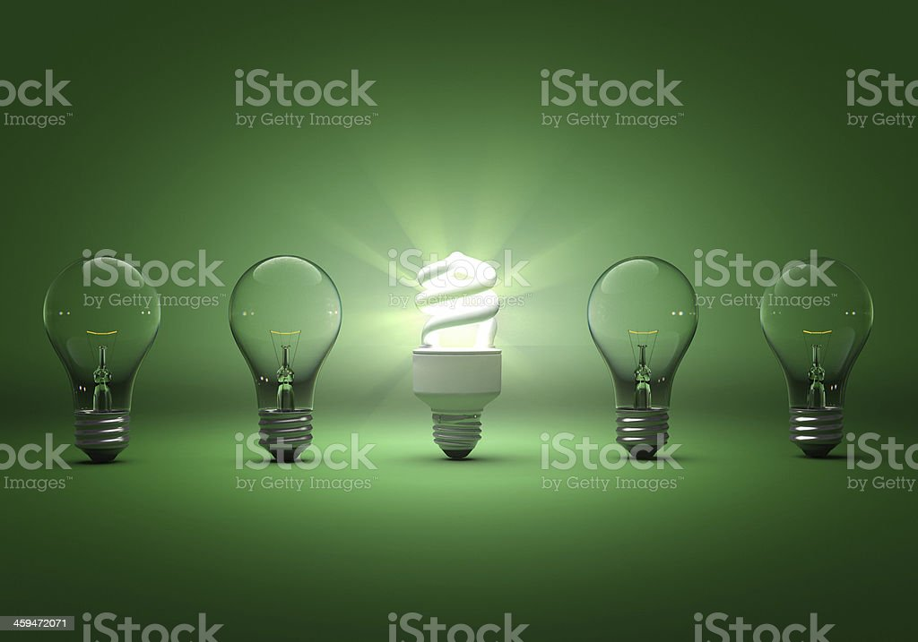 Five lightbulbs on a green background stock photo
