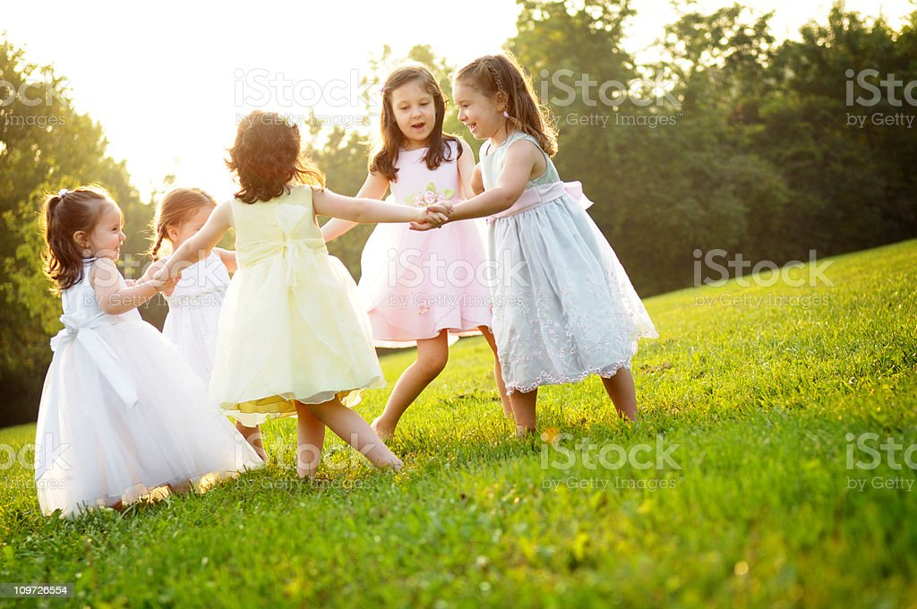 Five Little Girls Holding Hands and Spinning in a Circle royalty-free stock photo