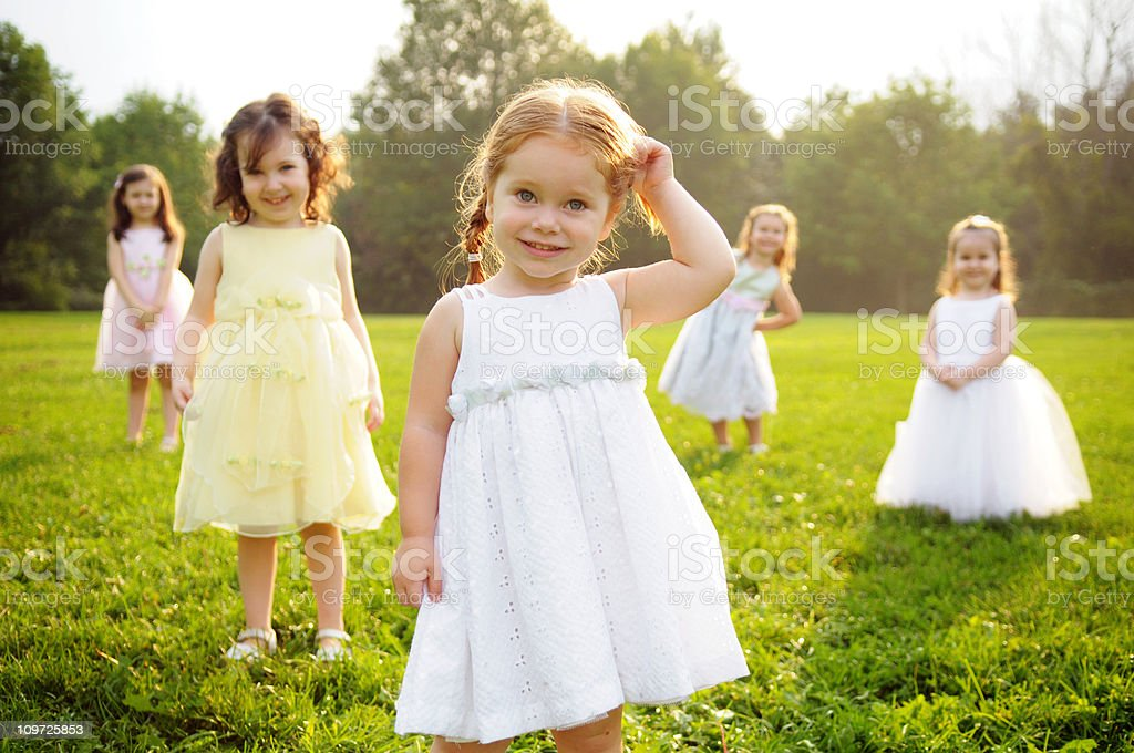 Five Little Girls Wearing Dresses and Standing in Grass royalty-free stock photo