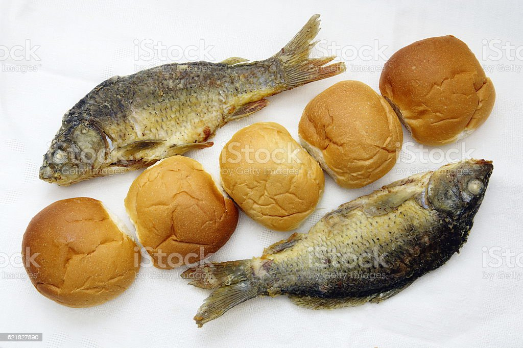 Five loaves, and the two fishes stock photo