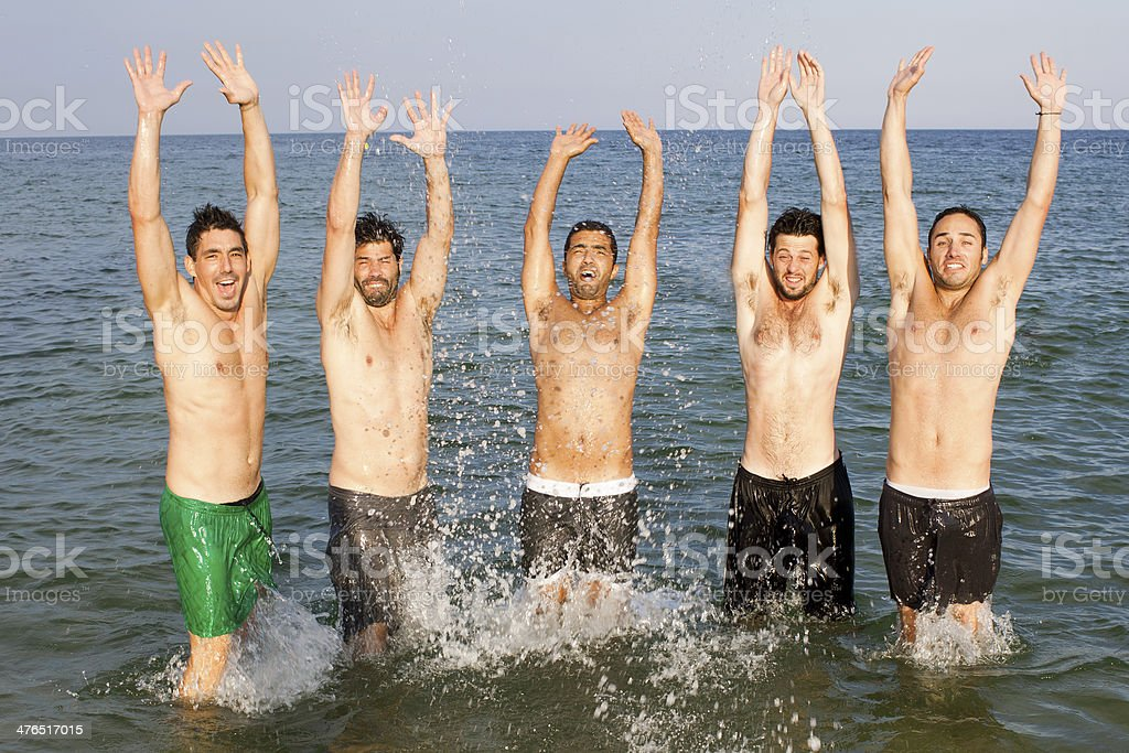 Five male friends on beach holidays royalty-free stock photo