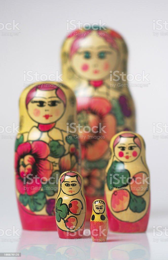 Five matryoshkas, the smallest on foreground royalty-free stock photo