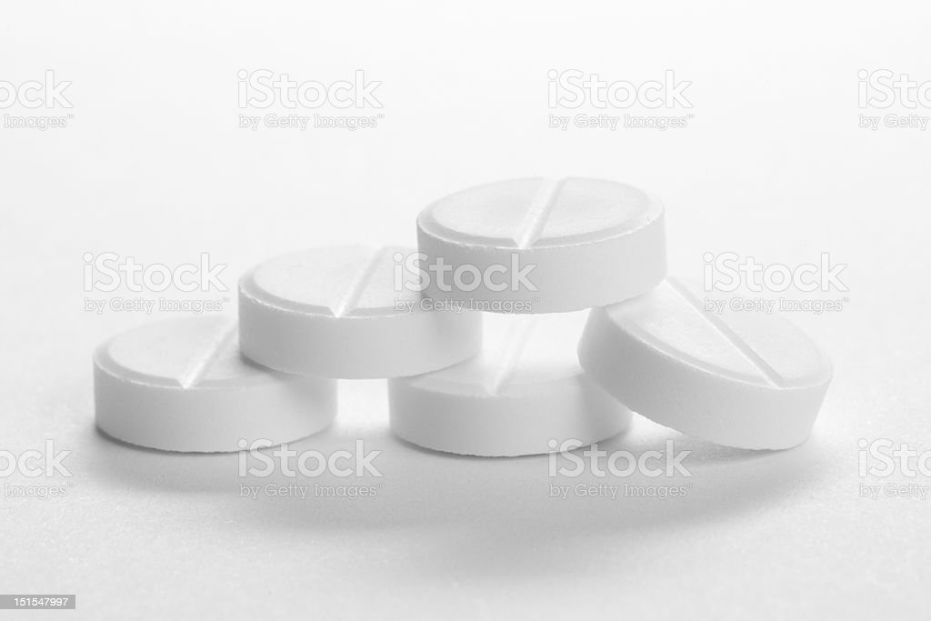 five medical pills, isolated on white royalty-free stock photo