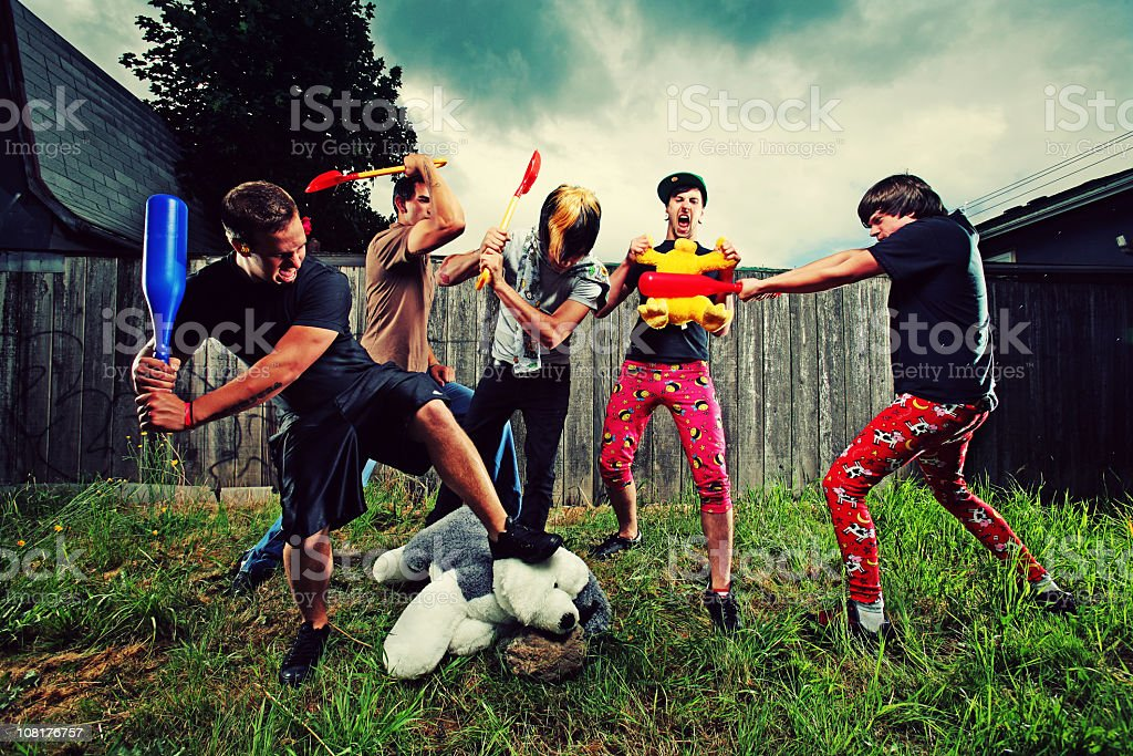 Five Men Playing with Plastic and Stuffed Animals royalty-free stock photo