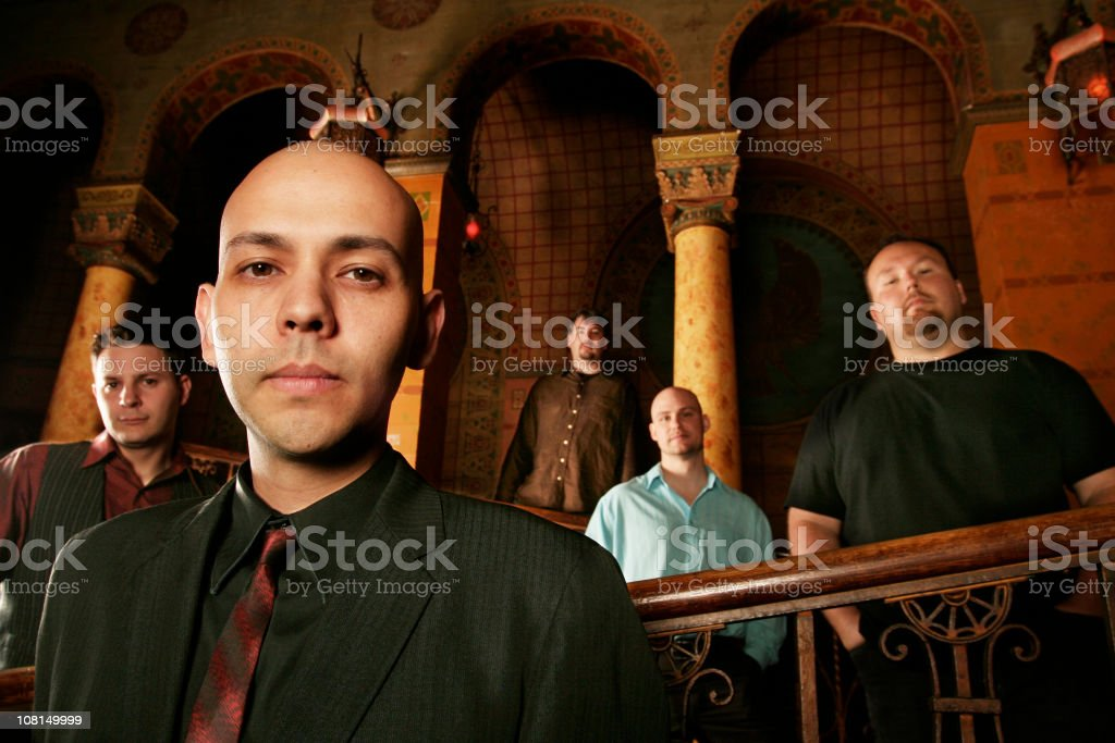 Five Men Standing in Ornate Architectural Building royalty-free stock photo