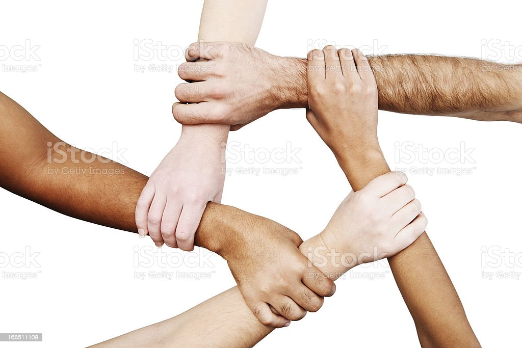 Five multiracial hands linked in unity, forming a pentagon shape stock photo