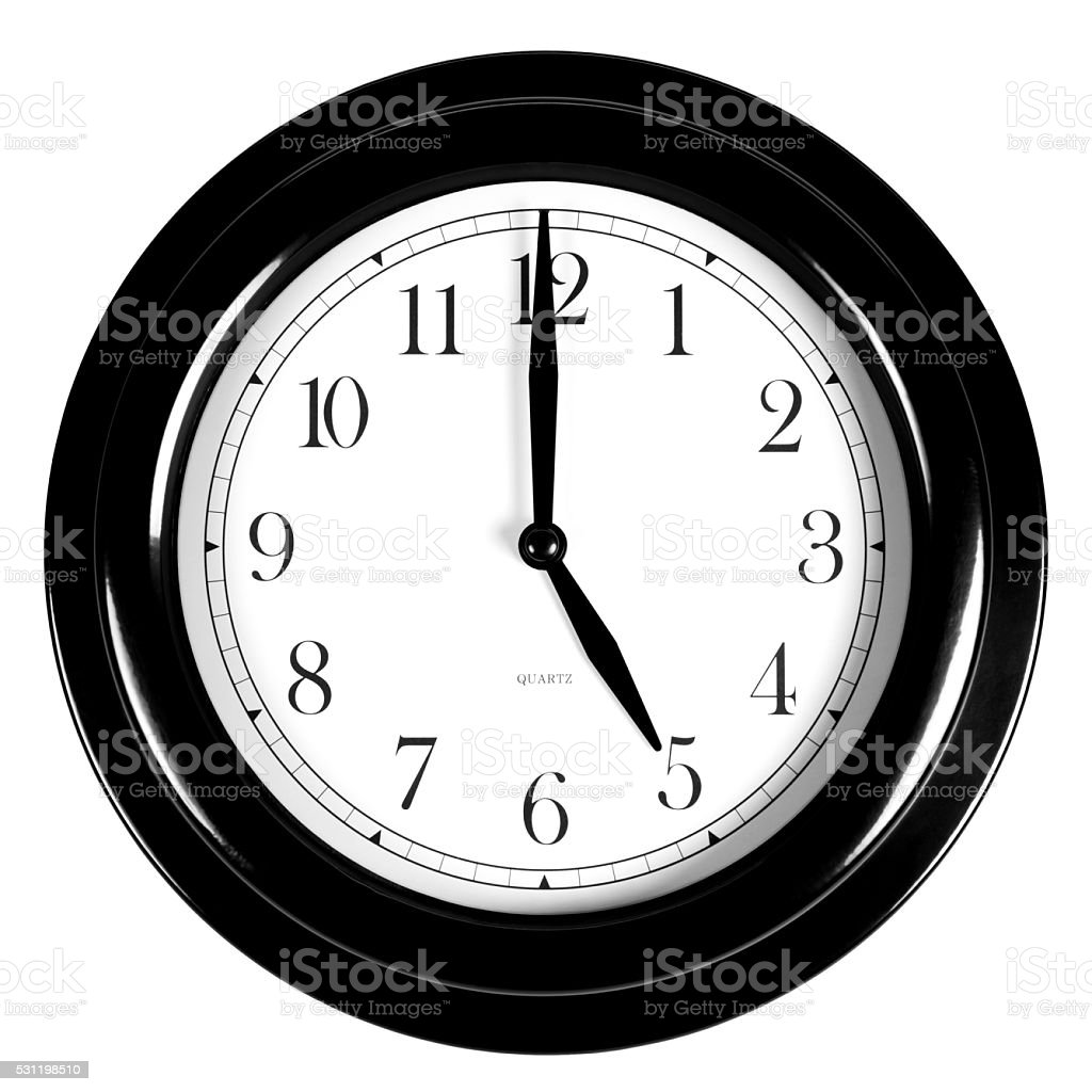 Five o'clock on the black wall clock stock photo