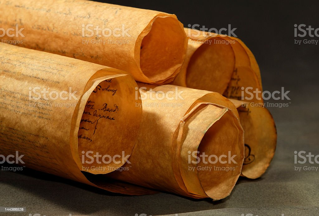 Five old scrolls laying on a grey table royalty-free stock photo
