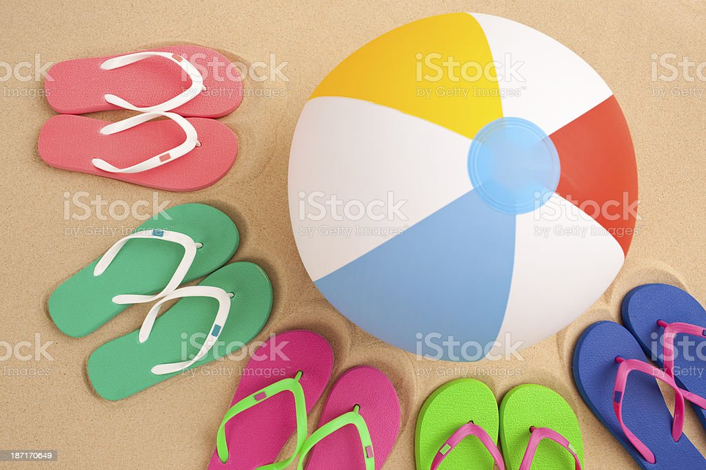 Five pair of flip flop and beach ball. royalty-free stock photo