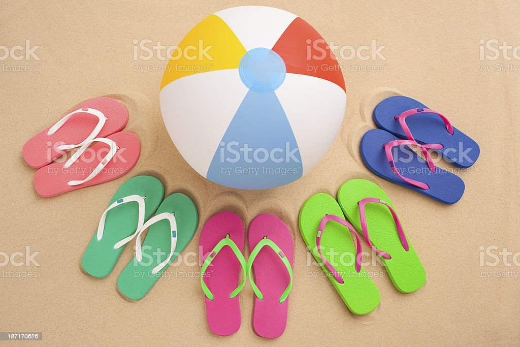 Five pairs of flip flop and beach ball. royalty-free stock photo