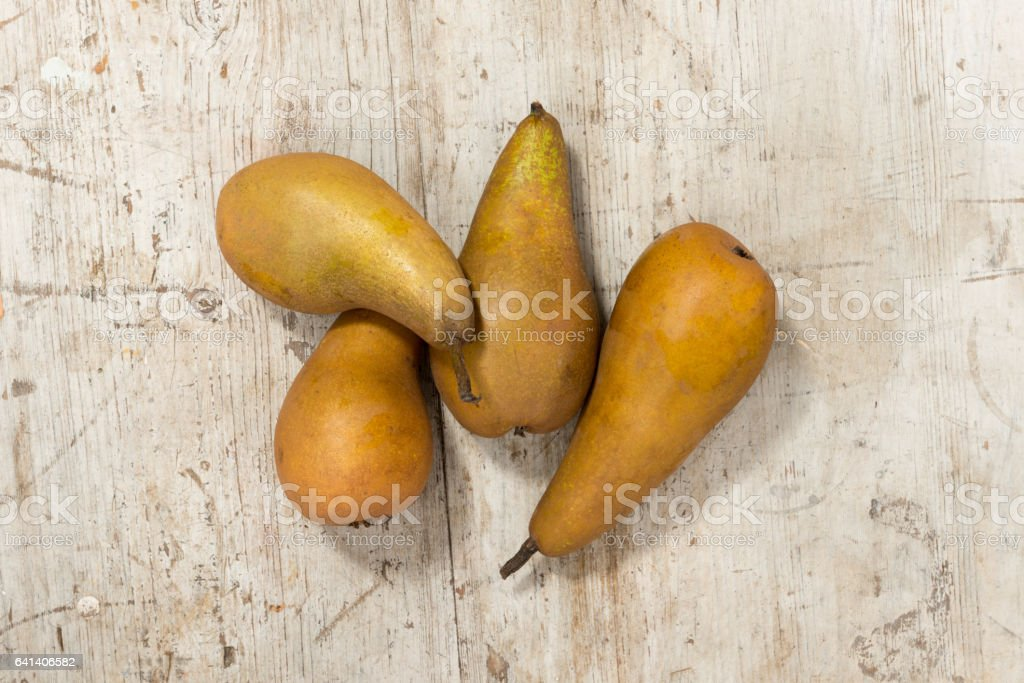 Five Pears on a Wooden Background stock photo
