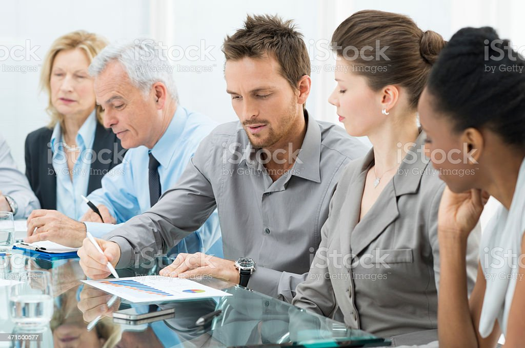 Five people in a meeting at work stock photo