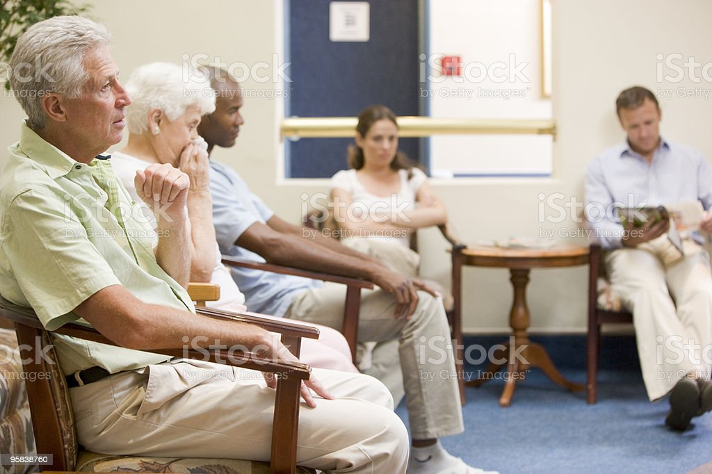 Five people in waiting room royalty-free stock photo