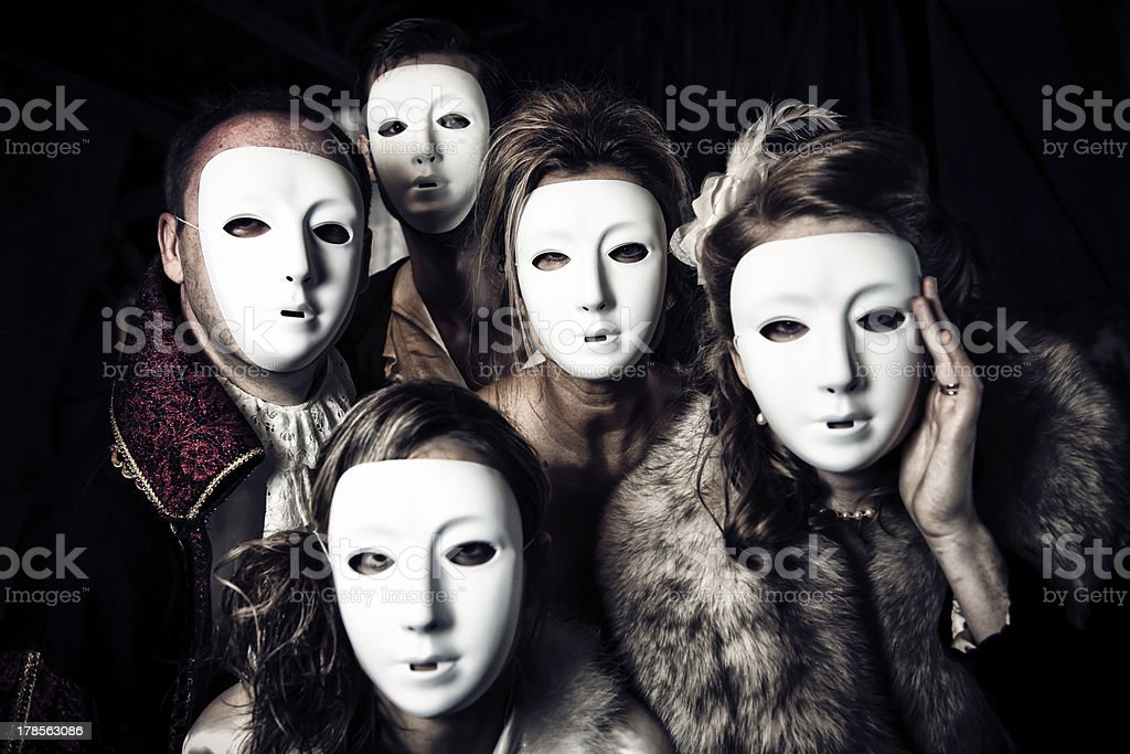 Five people masked ready to party stock photo