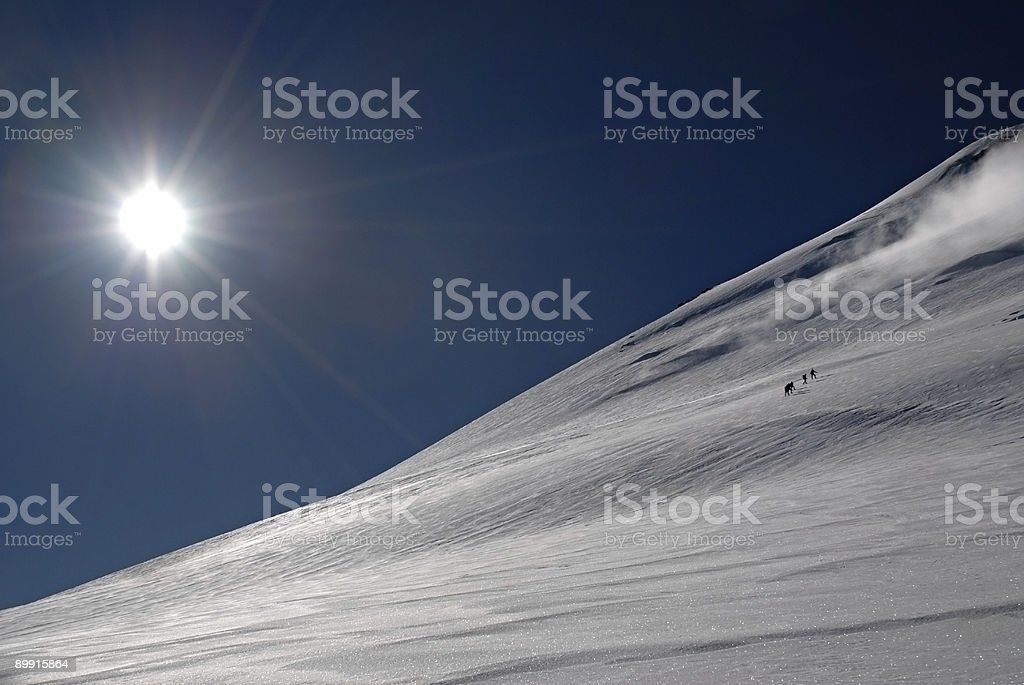 Five people trekking  to a top of mountain. royalty-free stock photo