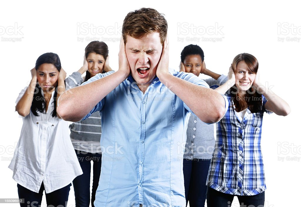 Five people with hands over their ears grimace at noise stock photo