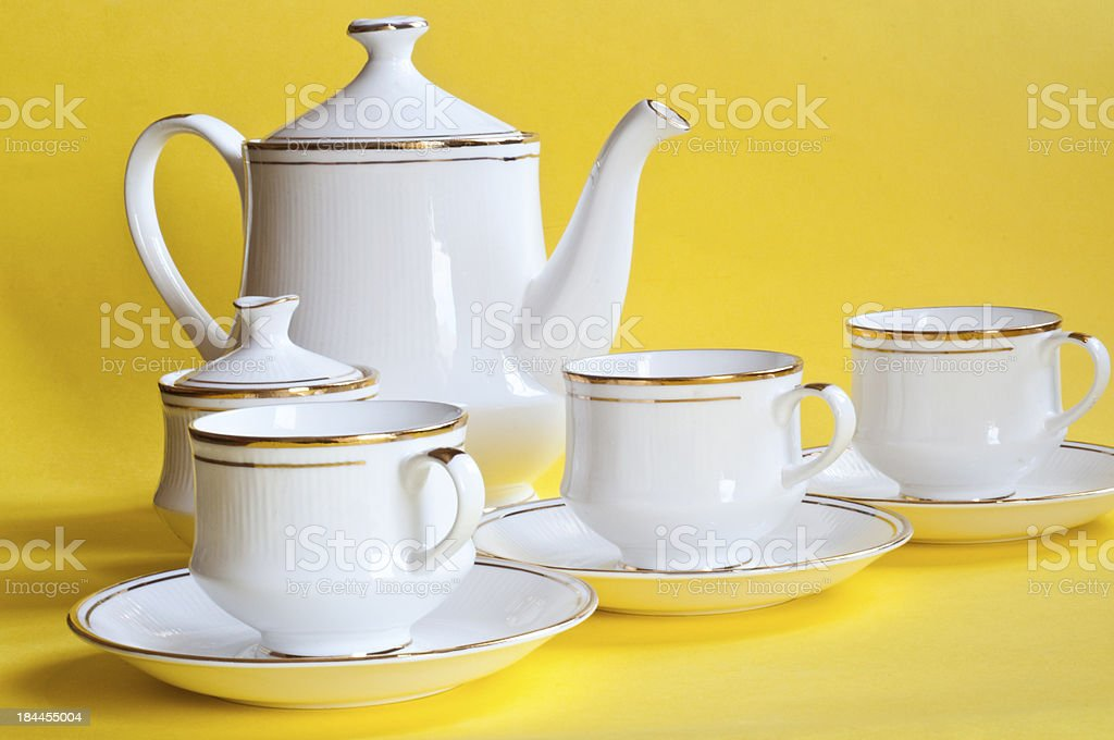 Five piece tea set against yellow background royalty-free stock photo