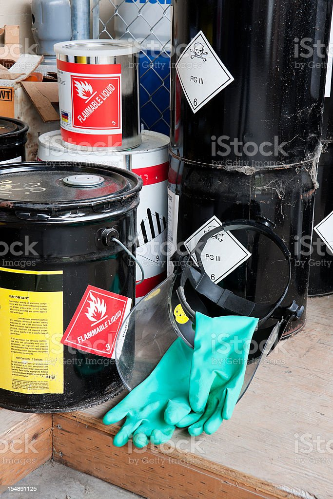Five piled buckets containing flammable liquids stock photo