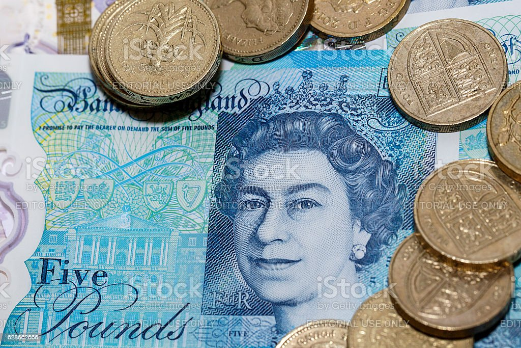 Five Pound Note and One Pound Coins stock photo