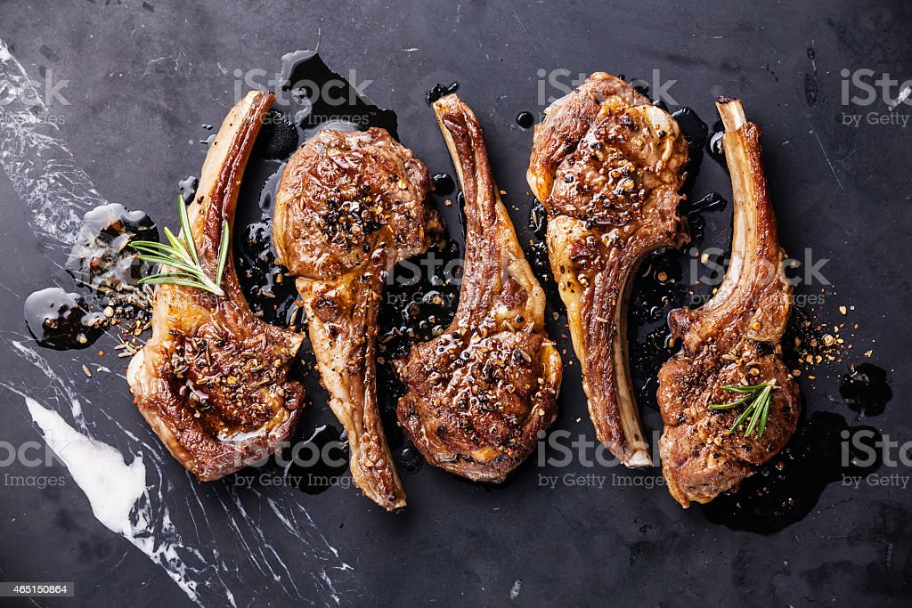 Five roaster lamb ribs with herbs stock photo