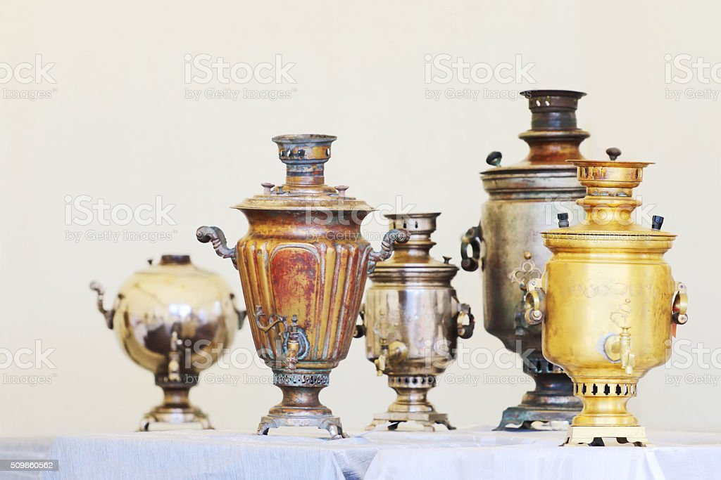 Five Russian samovars of different shapes stock photo