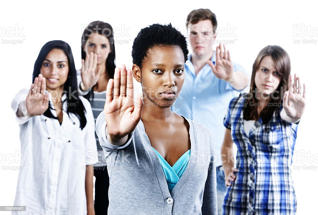 "Five serious young people indicate ""Stop""  holding up their hands royalty-free stock photo"