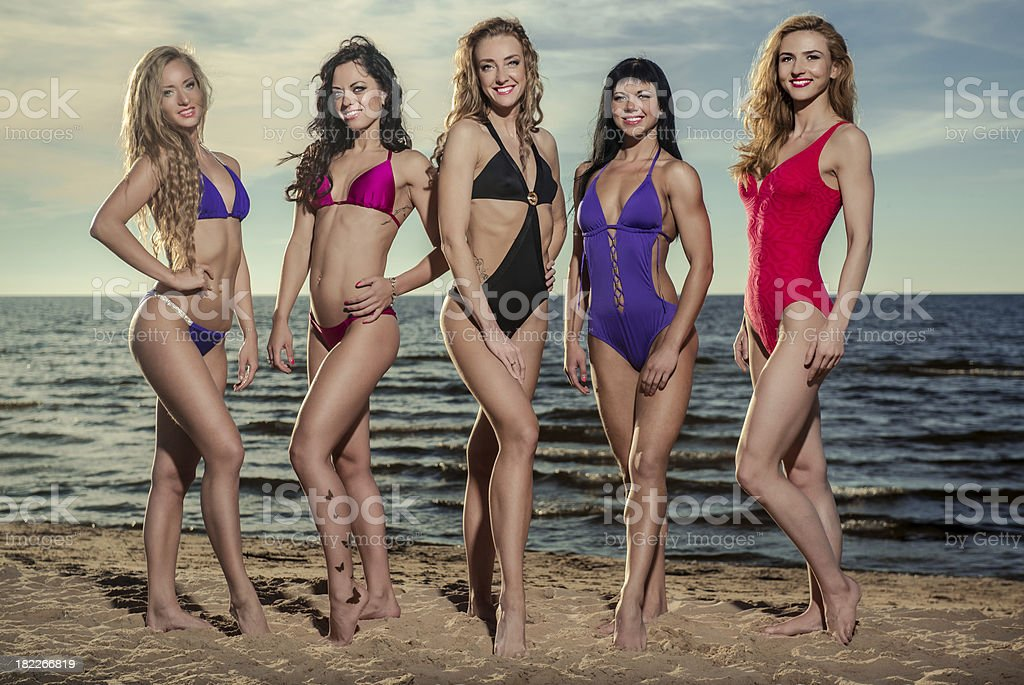 Five sexy ladies on the beach royalty-free stock photo
